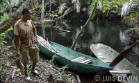 Pygmy fisherman returning from fishing on a pirogue