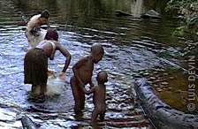 Luis Devin studying the water drums of the Baka Pygmies