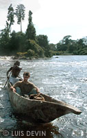 Luis Devin in a large pirogue on a river