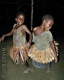 Young Pygmy girls dancing a participation dance